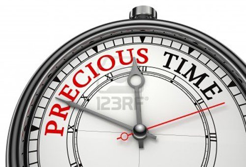 12727913-precious-time-concept-clock-closeup-isolated-on-white-background-with-red-and-black-words