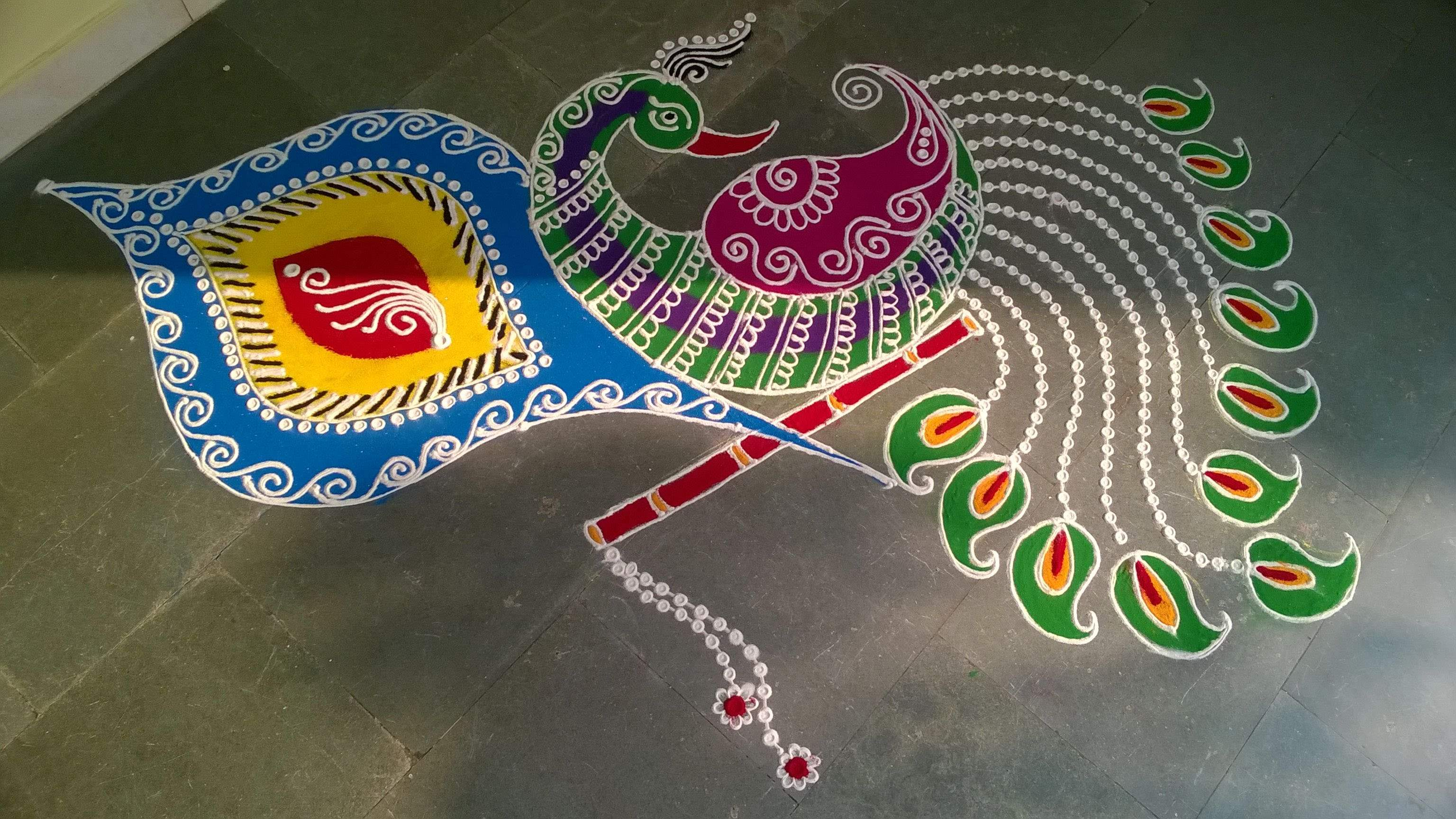 Diwali floor decoration ideas lightening stars on earth for Floor rangoli design
