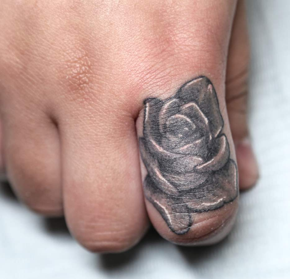 Flower on Finger as Tattoo designsmag.com