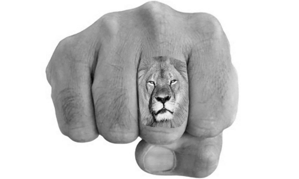Lion on Finger Tattoo