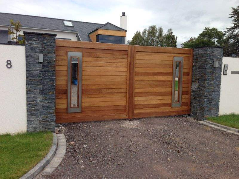 35 stunning modern main gate design for home decoration for Wooden main gate design