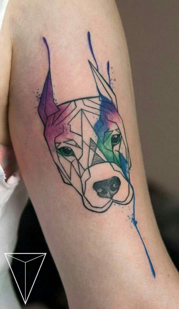 dog tattoos on arm with watercolor